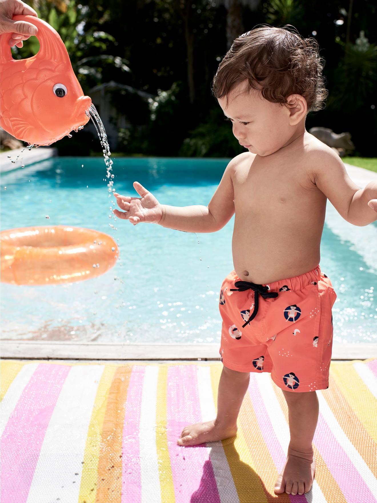 Maillot de bain short bébé imprimé orange fluo